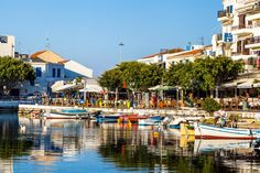 Boats and cafe restaurants on Lake Voulismeni. Agios Nikolaos, Crete, Greece.