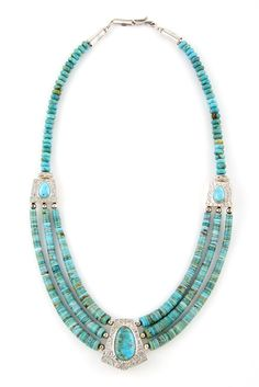 This reversible turquoise necklace was made by Navajo husband and wife silversmiths, Mary and Everett Teller.