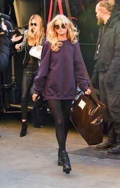 Elsa Hosk in blonde curls, a sweatshirt and killer cat eye sunglasses