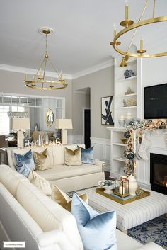 Elegant Christmas living room - Christmas decor with light blue, gold and warm white. Elegant Christmas living room using soft blues, gold, silver and warm whites sets a sophisticated scene with this oh-so-chic color palette! Blue And Gold Living Room, Blue Living Room Decor, Glam Living Room, Elegant Living Room, Living Room Designs, Blue Home Decor, Living Room Decor Gold, White Living Room Furniture, Living Room With Color