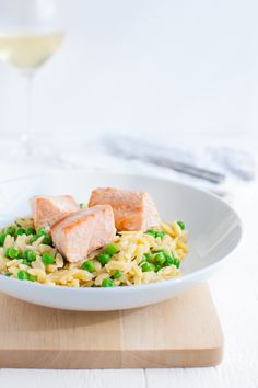 One Pan Parmesan Orzo with Salmon and Peas - Everything you need for a delicious meal in one pan and under 40 minutes - salmon, pasta, peas, and, most importantly - cheese! | tamingofthespoon.com