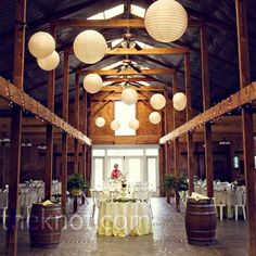 I need my wedding to be here. Paper lanterns, a must. I also love the rustic look and the string lights!