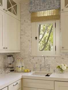 White & Gray kitchen. Love the carerra marble subway tile backsplash.