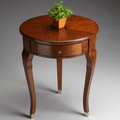 Side Table - Chestnut Burl - 6014108. Side Table - Chestnut Burl - 6014108 Selected hardwoods, wood products and cherry veneer. Brushed nickel finished leg caps and hardware on single drawer. Product Specifications Dimensions 22 Diam. x 26 H (inches) Finish_Mat.. . See More Side Tables at http://www.ourgreatshop.com/Side-Tables-C689.aspx