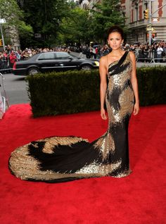 Pin for Later: See 100+ Insanely Gorgeous Looks From Met Galas Past Nina Dobrev The star made her presence know at the 2012 Met Gala in a daring Donna Karan Atelier gown with a dramatic train.