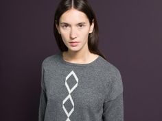 WOLFEN GERMANY /  The wide cut sweater with rhomb pattern in front has been knitted from 100% soft lambswool.