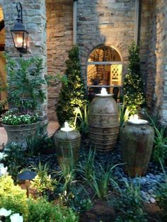 A disappearing fountain is a great way to add the sound of water to your garden! You can create them using just about anything as your favorite fountain piece, then finish it off with the covering. Backyard Patio Designs, Yard Design, Front Yard Landscaping, Landscaping Ideas, Garden Water Fountains, Water Garden, Water Walls, Water Features In The Garden, Plein Air