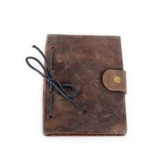 "Rustic and practical, our new Raleigh Journal is a reliable companion for wherever your writing takes you. Now featuring a pen loop, dot-grid pages, and top-grain leather. - 5.25"" x 6.75"" - 192 dot-gr"