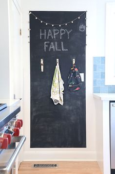 Chalkboard Wall with birch branch hooks  hmmm might try this on my basement door?