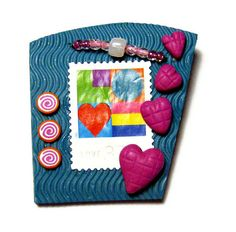 An abstract US postage LOVE stamp, 3-D hearts, beads, and a wavy texture create a mini-work of art to wear!  Handmade Valentine's Day pin by SweetchildJewelry
