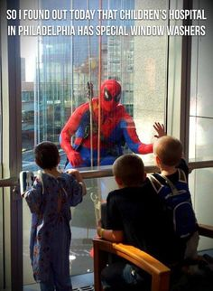 This Window Washer is a HERO!  Children's hospital in Philadelphia......has special window washers.....I spy Spiderman!!!