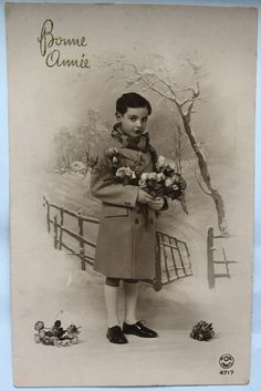 French little boy in warm winter holding flowers Happy New