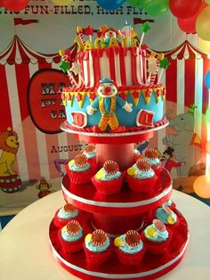 Carnival cake with cupcakes (red,yellow,blue rainbowchip icing)(fondant cake)