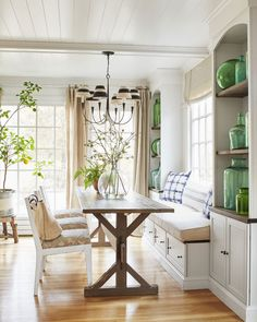 The designer's home is filled with subtle pops of green and blue, like the indigo print breakfast nook pillows in her kitchen, which the couple remodeled in 2010. As part of the overhaul, she took down a wall that divided it from the adjacent dining room, added windows, and installed lots of reclaimed wood shelves. By the sink, she keeps dishware, bread board, and potted herbs in view and within reach.