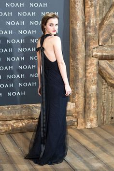 Emma Watson in a Wes Gordon dress, Christian Louboutin heels, and Ana Khouri earrings at the Berlin premiere of Noah. See all of the actress's best looks.