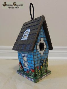 """Mosaic Bird House """"Home Tweet Home"""". Made with Venetian tiles, millefiori, Smalti, mirror, ABC beads on wood.  Height: 23 cm (about 9 inches) Width: 10 cm (about 4.5 inches) Lenght: 12 cm (about 5.5 inches) #JoGranadosMosaic #JohannaGranadosMosaicsandPaintings"""