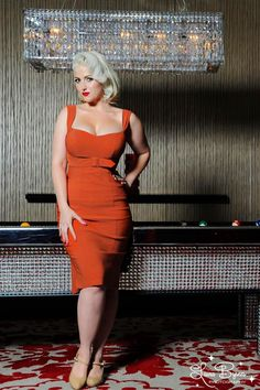 """Jessica Dress in Rust Solid Bengaline  - Made from the highest quality stretch bengaline that is soft, not scratchy, and holds you in while hugging your curves! Features include a fitted, structured """"wiggle"""" silhouette, shoulder straps and a front belt that enhance the bustline and slim the waist, and a kick pleat at the back provides ease of movement."""