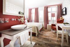 Das Mohnblumenzimmer - einer von sieben verschiedenen, thematisch gestalteten Räumen im Hotel Grenzhof Heidelberg
