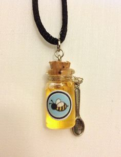 Classic Honey Glass Bottle Charm. $9.00, via Etsy.