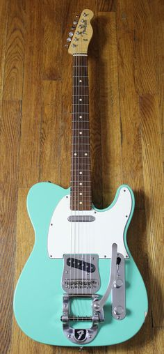 *This guitar has a factory installed Bigsby - holds tune and plays smooth. 2000 Fender Custom Shop Relic'ed Telecaster Sea Foam Green Guitar. It has a ton of playability and vintage vibe to go along with its tasteful relic'ing.