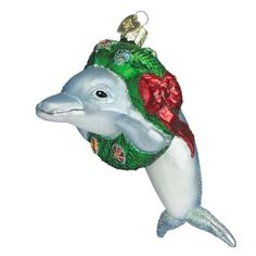 "Christmas Dolphin Christmas Ornament 12036 4 1/2"" Merck Family's Old World Christmas Playful bluish/gray dolphin with a Christmas wreath around its neck. Dolphins are nature's"
