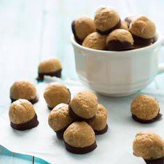 Healthy Peanut Butter Buckeyes are full on peanut buttery goodness minus the guilt. Naturally sweetened, protein-rich snacks AND dipped in dark chocolate!