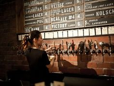 Love the taps mounted right to the brick, and the scoreboard style beer listing.