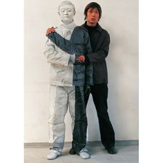 Identity and anonymity of the individual. The art of Liu Bolin, the artist is painted into his backgrounds.