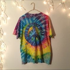 """Vintage oversized peace tie dye tee Super cute and comfortable. Amazing tie dye blend with a peace sign. Great oversized and can be a dress on girls 5'4"""" and under. Oversized and not brandy Brandy Melville Tops Tees - Short Sleeve"""