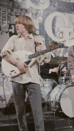 Rolling Stone Brian Jones with his Vox Teardrop on stage. Circa mid 1960's