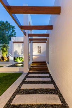 Contemporary pergola landscape garden in Perth with black pebble path   Revell Landscaping Perth