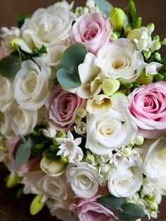 Bridal bouquet of pink 'sweet avalanche' roses, ivory 'akito' roses, white bouvardia and freesias