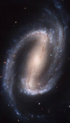 "Galaxy NGC1300. NGC 1300 is a barred spiral galaxy about 61 million light-years away in the constellation Eridanus. The galaxy is about 110,000 light-years across (about 2/3 the size of the Milky Way). It is a member of the Eridanus Cluster, a cluster of 200 galaxies. In the core of the larger spiral structure of NGC 1300, the nucleus shows a ""grand-design"" spiral structure, a spiral within a spiral, that is about 3,300 light-years long."