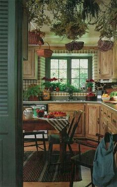 October 1991 issue. The rustic kitchen, with its pine cabinetry, checked wall coverings, dried herbs suspended from the ceiling, and Pennsylvania painted chairs, was part of a feature on Peggy and Larry Teich's 1840s fieldstone house near Milwaukee, Wisconsin.