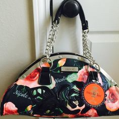 Nicole Lee  handbag  Beautiful brand new  Nicole Lee  handbag. Size 15Lx 6H x 6W. This purse uniquely designed and has 2 separate compartments with zippers. Please let me know if you have any questions or more photos. Thank you  Nicole Lee Bags Shoulder Bags