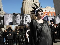 Dramatic scenes in Washington Square Park during the anti-Trump rally — a far cry from the pro-Trump scenes in Florida. Picture: AFP