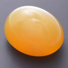 Moonstone is the most well known variety of orthoclase feldspar. Here's a candy-like soft orangy yellow color oval moonstone cabochon.