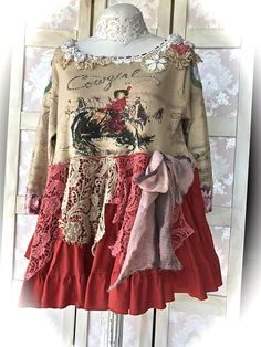 Comfortable, unique tunic/ jumper dress/top. Front motif of a Bucking Bronco With Cowgirl Rider with twinkles and beads. Neckline Decorated with raglan roses,rustic cut dimensional lace,vintage crochet trim, ribbon and mini doilies and buttons. Sleeve tops at the shoulder area have