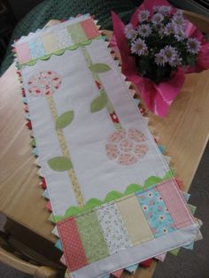 sweet Spring table runner.  Love the prairie points along the edges.