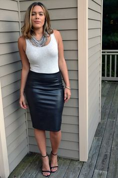 Amateur blonde at home in black leather skirt and ankle strap heels