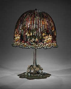 Leaded Favrile glass and bronze lamp ). Designed by Louis Comfort Tiffany ( ). Made by Tiffany Studios Image and text courtesy The Met. Tiffany Glass, Tiffany Stained Glass, Stained Glass Lamps, Leaded Glass, Mosaic Glass, Old Lamps, Antique Lamps, Antique Lighting, Vintage Lamps