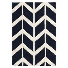 Hand-woven wool rug with a herringbone-inspired design.    Product: RugConstruction Material: 100% WoolColor: Ink and winter whiteFeatures:  Hand-wovenMade in India Note: Please be aware that actual colors may vary from those shown on your screen. Accent rugs may also not show the entire pattern that the corresponding area rugs have.Cleaning and Care: Blot stains