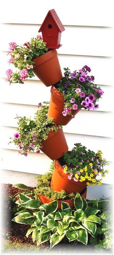 DIY Tipsy Vertical Pot Planter Projects & Instructions: Bucket, Container Gardening, Hanging Flower Pot, Flower Tower, Bath Tub Flower Tower Fountain and Hanging Flower Pots, Flower Planters, Diy Planters, Planter Pots, Clay Pot Projects, Clay Pot Crafts, Diy Projects, Lawn And Garden, Garden Pots
