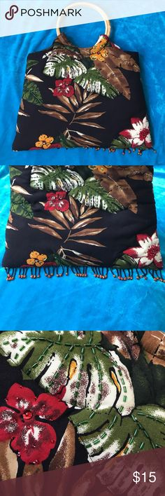 """SPA Aloha bag Black Aloha bag with Hawaiian flowers. Wooden handles, they can be moved around(they don't come off).One side of the bag has sequins & little beads on the some flower and the some plants - the other side does not. Bead detail on the bottom, very cute bag. Soft pillow(ish) fabric. 14 1/2"""" in width & 17 inches height (handles included). No rips, some scrapes on wood( see pic) Non-smoking home & pet free home Bags"""