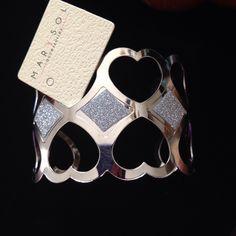 Boutique brand Heart cuff bracelet Beautiful boutique brand silver cuff bracelet with cut out hearts and diamonds. Goes beautifully with any wardrobe piece. Marysol Jewelry Bracelets