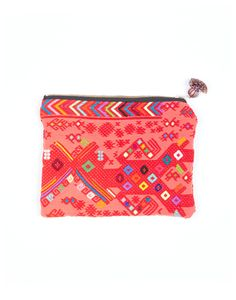a woven cosmetic bag that gives back to female artisans in Guatemala.