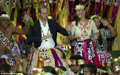 The Royal couple participate in a traditional island dance, known as Fatele, after arriving in Tuvalu