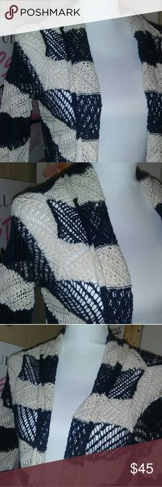 Ralph Lauren Crochet Top Brand new with tags and zero defects! This top is highly versatile. The crochet makeup makes this garment suitable over a blouse during the summer for a day sailing or with a  turtleneck during the winter at the office. The navy blue color is perfectly paired with the beige.  Material 75% cotton 25% linen Ralph Lauren Tops