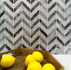 Carrara marble backsplash in a chevron pattern