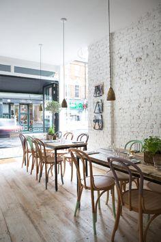 simple white café interior vibrant ambience